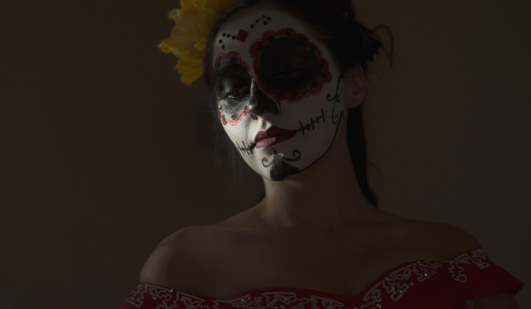 A model is pictured a press reception ahead of the 15th annual Dia de los Muertos, or Day of the Dead, festival at Hollywood Forever Cemetery in Los Angeles, California October 24, 2014. The Day of the Dead festival has its origins in a pre-Hispanic Aztec belief that the dead return to Earth one day each year to visit their loved ones. The festival will be held on November 1. (Mario Anzuoni/Reuters)
