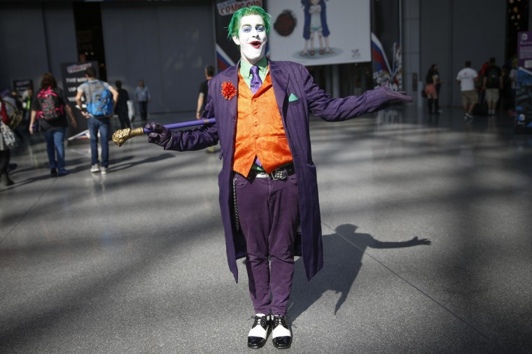 "Trevor Olson, from Minnesota, dressed as the character ""Joker"", poses for a photograph at New York's Comic-Con convention October 9, 2014. The event draws thousands of costumed fans, panels of pop culture luminaries and features a sprawling floor of vendors in a space equivalent to more than three football fields at the Javits Center. Shannon Stapleton/Reuters photo"