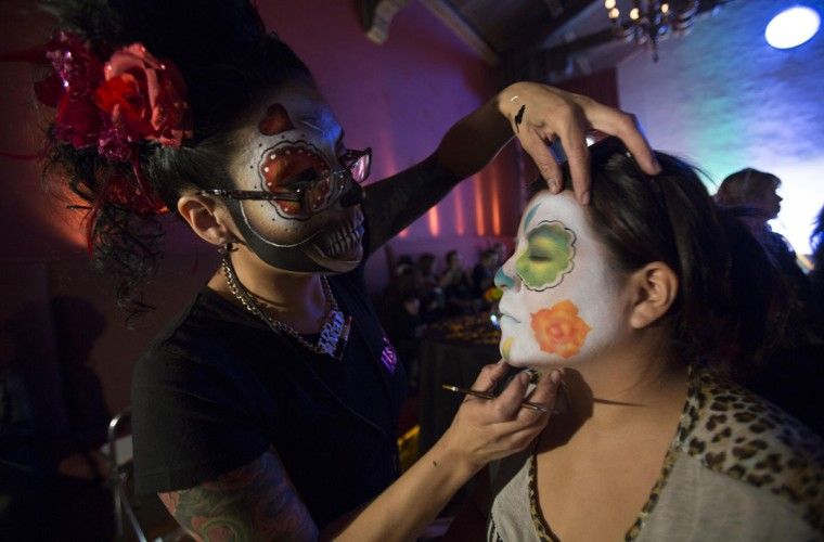 Make-up artist Livier (L) applies make-up on Abigail Granados at a press reception ahead of the 15th annual Dia de los Muertos, or Day of the Dead, festival at Hollywood Forever Cemetery in Los Angeles, California October 24, 2014. The Day of the Dead festival has its origins in a pre-Hispanic Aztec belief that the dead return to Earth one day each year to visit their loved ones. The festival will be held on November 1. (Mario Anzuoni/Reuters)