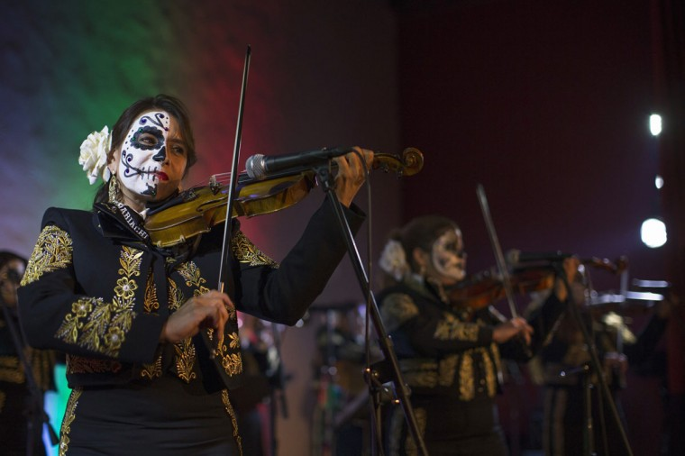 The band Mariachi Divas de Cindy Shea perform at a press reception ahead of the 15th annual Dia de los Muertos, or Day of the Dead, festival at Hollywood Forever Cemetery in Los Angeles, California October 24, 2014. The Day of the Dead festival has its origins in a pre-Hispanic Aztec belief that the dead return to Earth one day each year to visit their loved ones. The festival will be held on November 1. (Mario Anzuoni/Reuters)