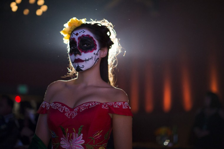 A model is pictured during a Quinceanera Magazine Catrina fashion show at a press reception ahead of the 15th annual Dia de los Muertos, or Day of the Dead, festival at Hollywood Forever Cemetery in Los Angeles, California October 24, 2014. The Day of the Dead festival has its origins in a pre-Hispanic Aztec belief that the dead return to Earth one day each year to visit their loved ones. The festival will be held on November 1. (Mario Anzuoni/Reuters)