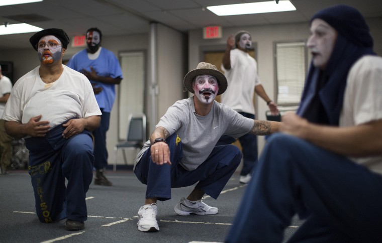 """Inmates participate in the workshop """"Commedia Dell'Arte"""", part of the The Actors' Gang Prison Project program at the California Rehabilitation Center in Norco, California September 30, 2014. The program was created in 2006 to teach participants to develop empathy, express themselves in a positive manner and create healthy relationships. Picture taken September 30, 2014. (Mario Anzuoni/Reuters)"""