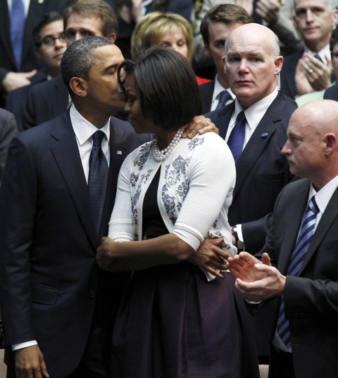 "U.S. President Barack Obama (L) and first lady Michelle Obama are applauded by attendees, as then-U.S. Secret Service Special Agent Joseph Clancy (2ndR) keeps watch at the ""Together We Thrive: Tucson and America"" event held to support and remember victims of the mass shooting, at the University of Arizona in Tucson, Arizona, in this January 12, 2011 file photo. U.S. Secret Service Director Julia Pierson resigned under fire on October 1, 2014, and Joe Clancy has been named acting director. Former NASA shuttle commander Mark Kelly applauds at right. (Jim Young/Files/Reuters)"