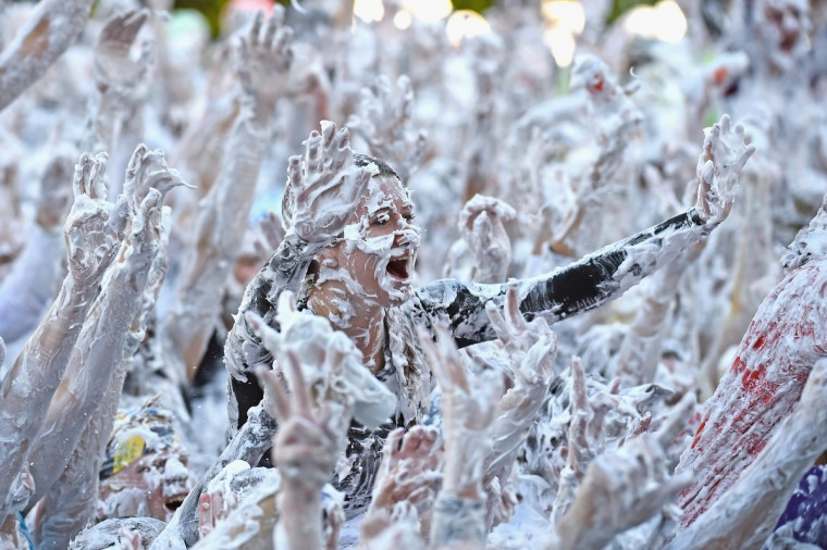 Students from St Andrew's University indulge in a tradition of covering themselves with foam to honor the 'academic family' on October 20, 2014, in St Andrews, Scotland. (Jeff J Mitchell/Getty Images)