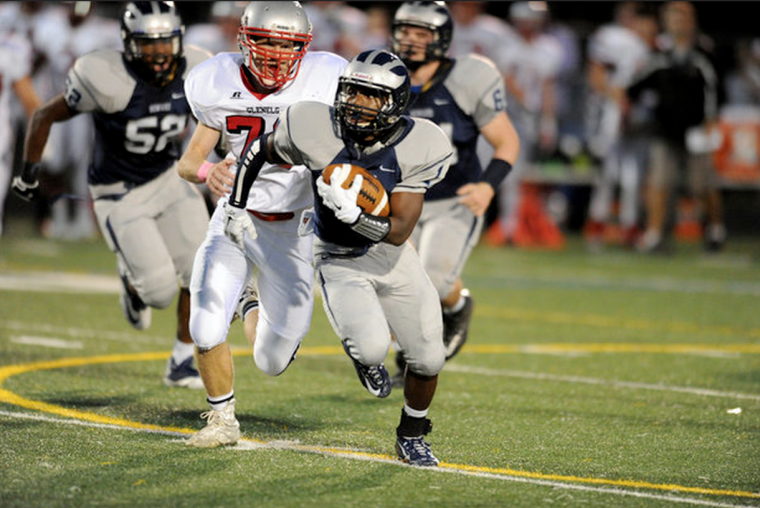 Howard running back Malik Anderson is chased from behind by Glenelg's Zach Hahn on a play resulting in a first down. (Brian Krista/BSMG)