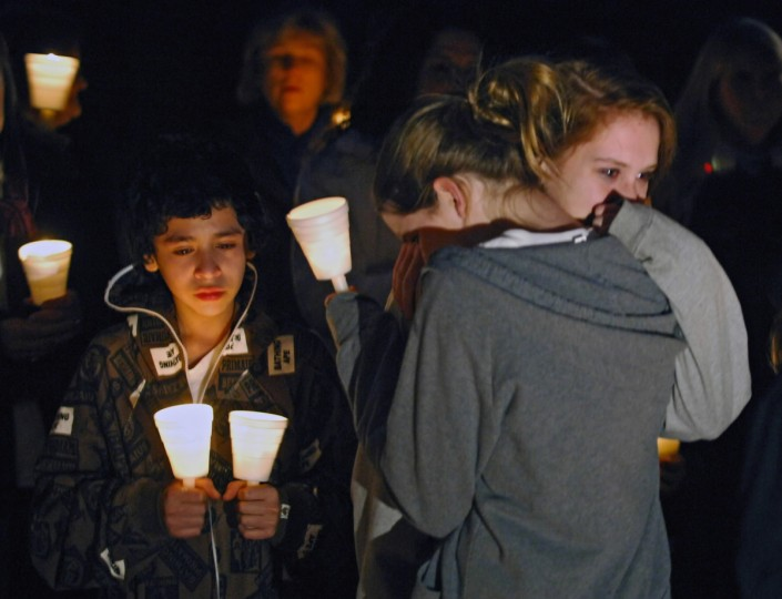 Students from Cockesville Middle School, their parents and neighbors gather at the Brownings' home for a candlelight vigil. Four members of the Browning family were murdered in their home in February 2008. The oldest son, Nick Browning, a student at Dulaney High, was convicted in the killings. Millicent Himbor, 13, right, is comforted by a friend after Himbor and Gabe Ford, 13, left, spoke about their friend Gregory Browning during the vigil. (Kenneth K. Lam/Baltimore Sun)