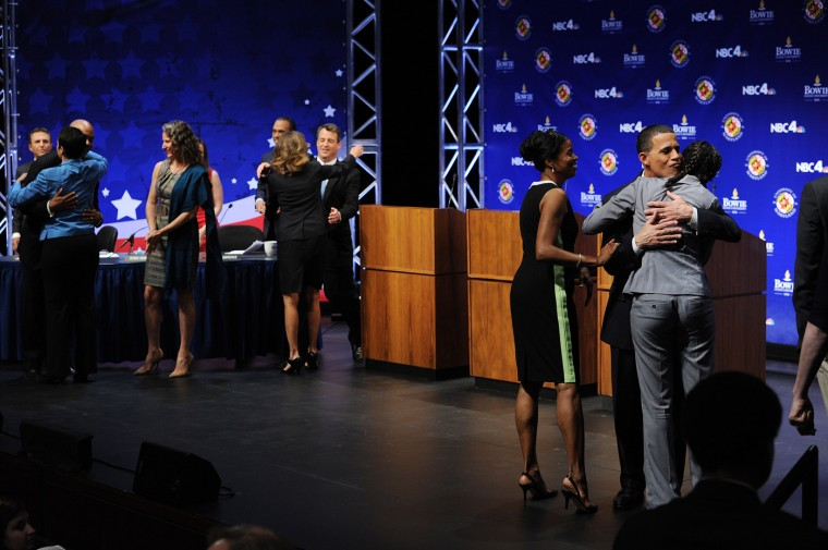 5/7/2014: Maryland State Delegate Heather Mizeur, far left with back to camera, Maryland Attorney General Doug Gansler, center, and Maryland Lieutenant Governor Anthony Brown, second from far right, is greeted by his wife, Karmen Walker Brown, right center, and his daughter, Rebecca Brown, far right, after the candidates took part in a Democratic primary gubernatorial debate at Clarice Smith Performing Arts Center, located on the grounds of the University of Maryland on Wednesday May 07, 2014 in College Park, MD. (Photo by Matt McClain/ The Washington Post)