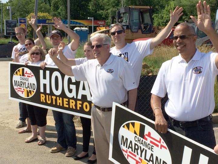 6/23/14: Larry Hogan (center) and running mate Boyd Rutherford are joined by Hogan family members in sign-waving along Ritchie Highway in Arnold Monday. (Michael Dresser/Baltimore Sun)