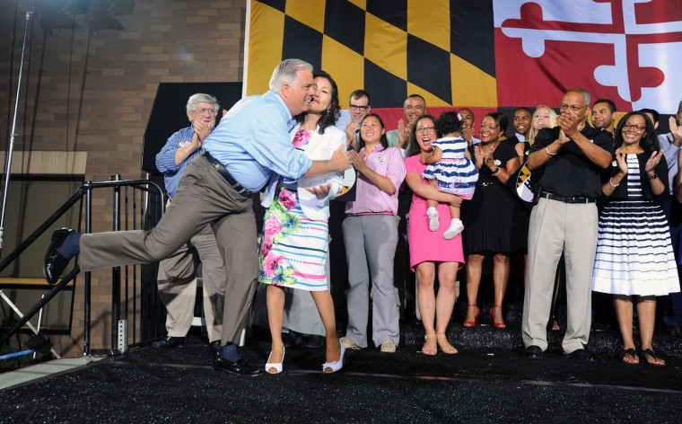 6/24/14: Republican gubernatorial candidate Larry Hogan, left, kisses his wife Yumi before declaring his primary victory to supporters outside their campaign headquarter. (Kenneth K. Lam/Baltimore Sun)