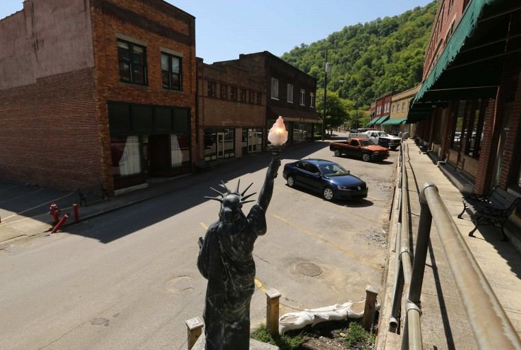 A replica of the Statue of Liberty is shown in downtown Matewan, West Virginia May 19, 2014. With coal production slowing due to stricter environmental controls, the availability of natural gas and a shift to surface mining, the state's coal country has been hit hard with job losses and business closures. Picture taken May 19, 2014. (Robert Galbraith/Reuters)