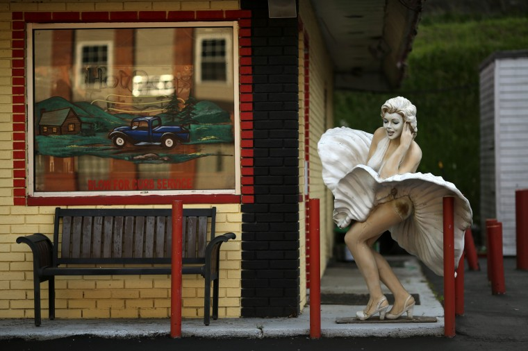 A statue of Marilyn Monroe is shown outside the now closed Happy Days Diner in Gilbert, West Virginia May 20, 2014. With coal production slowing due to stricter environmental controls, the availability of natural gas and a shift to surface mining, the state's coal country has been hit hard with job losses and business closures. (Robert Galbraith/Reuters)
