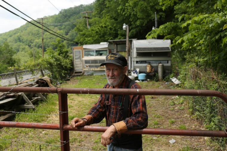 Wayne Cline, 70, stands outside his home near Iaeger, West Virginia May 21, 2014. Cline, a former coal miner, said he gets by on a $742 per month social security cheque. (Robert Galbraith/Reuters)