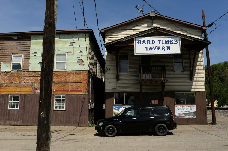 "A car is parked outside of the ""Hard Times Tavern"" in Fort Gay, West Virginia May 19, 2014. (Robert Galbraith/Reuters)"