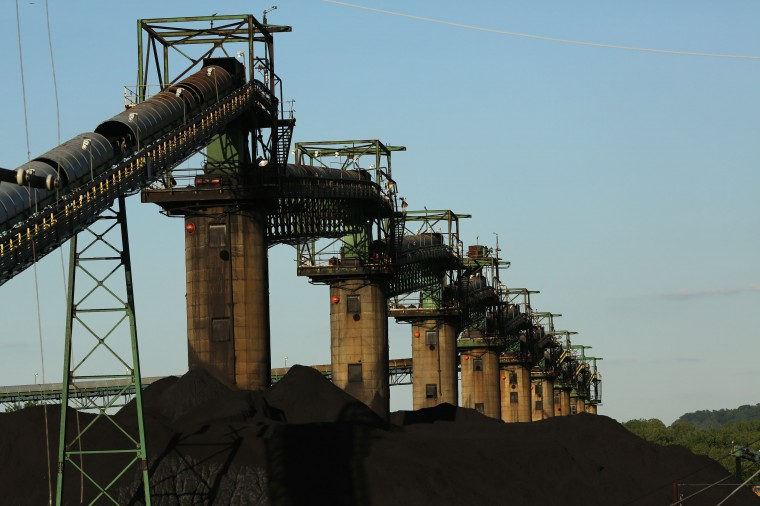 Coal is stacked at the base of coal loaders along the Ohio River in Ceredo, West Virginia May 18, 2014. (Robert Galbraith/Reuters)
