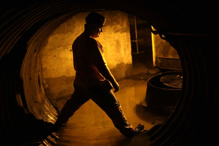 Coal miner Mike Hawks, 53, stands in an underground tunnel at a coal processing facility near Gilbert, West Virginia May 22, 2014. (Robert Galbraith/Reuters)