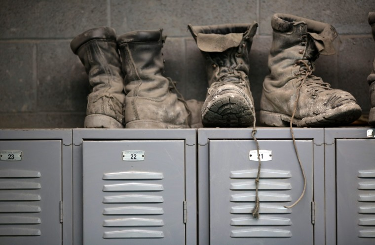 Coal mining boots are shown above miners' lockers before the start of an afternoon shift at a coal mine near Gilbert, West Virginia May 22, 2014. (Robert Galbraith/Reuters)