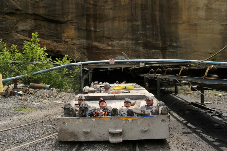 Coal miners enter a coal mine for the start of an afternoon shift near Gilbert, West Virginia May 22, 2014. (Robert Galbraith/Reuters)