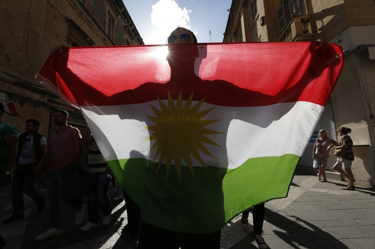 A member of the Kurdish community in Malta carries the Kurdish flag while protesting against Islamic State during a rally in solidarity with the people of the Syrian Kurdish town of Kobani, in Valletta. (Darrin Zammit Lupi/Reuters)