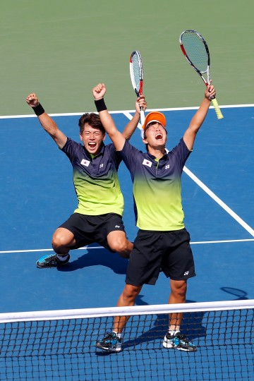 Kim Donghoon and Kim Beomjun of South Korea celebrate winning the Soft Tennis Men's Team Gold Medal Match competes against Hidenori Shinohara and Koji Kobayashi of Japan during day fifteen of the 2014 Asian Games at Yeorumul Tennis Courts in Incheon, South Korea. (Lintao Zhang/Getty Images)