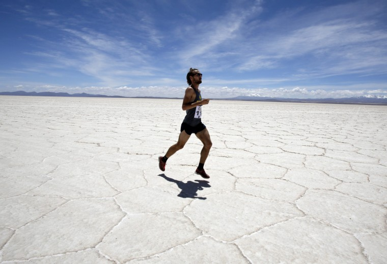 A participant runs across the salt flat as he takes part in the K42 race in Uyuni, some 450 km (280 miles) south of La Paz. Dozens of amateur runners participated in the K42 Adventure Marathon, a trail running race held in various continents. (David Mercado/Reuters)