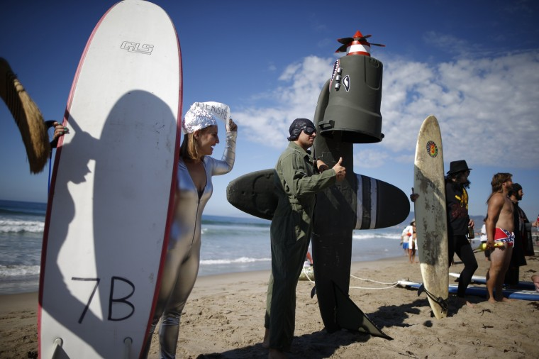 Competitors prepare to surf in the 7th annual ZJ Boarding House Haunted Heats Halloween surf contest in Santa Monica, California. (Lucy Nicholson/Reuters)