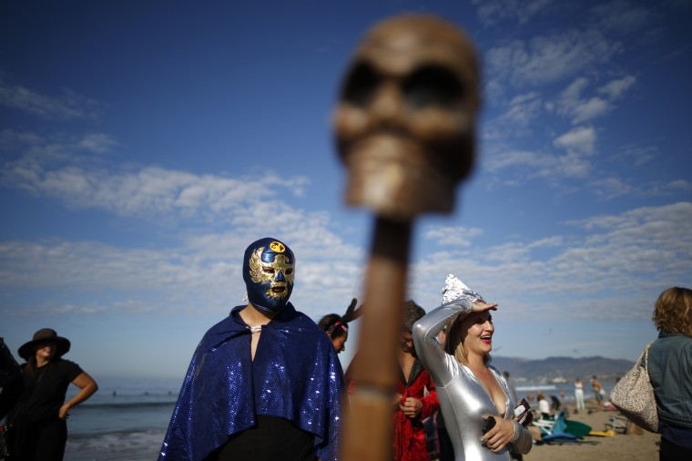 Competitors prepare to compete in the 7th annual ZJ Boarding House Haunted Heats Halloween surf contest in Santa Monica, California. (Lucy Nicholson/Reuters)