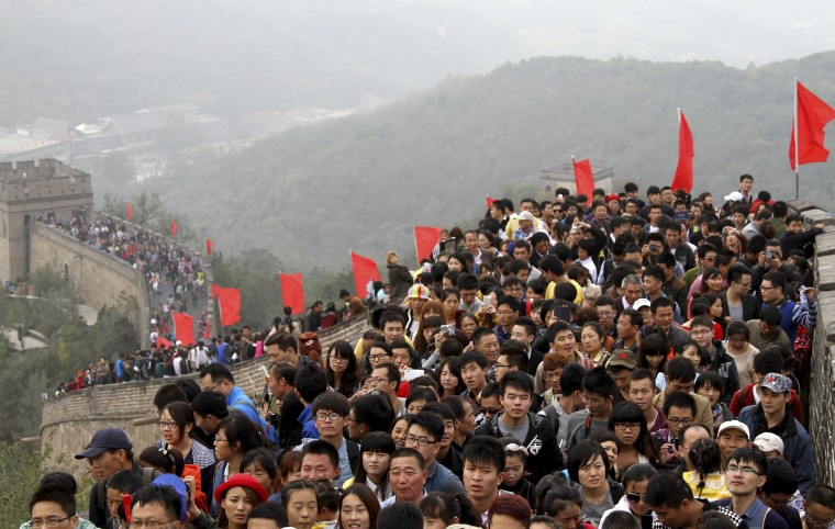 "Tourists visit the Great Wall on the third day of the seven-day national day holiday, on the outskirts of Beijing, October 3, 2014. The national day holiday, known by many Chinese as ""the Golden Week"" for travel, started on October 1 this year, celebrating the 65th anniversary of the founding of the People's Republic of China. According to a prediction by the China Tourism Academy, a total of 480 million trips are expected to be made by travelers within these seven days, Xinhua News Agency reported. (China Stringer Network/Reuters)"