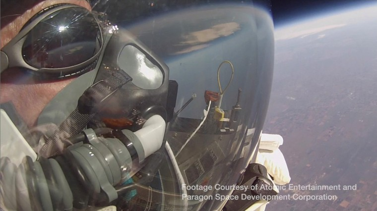 Google's vice president Alan Eustace looks out of his spacesuit into the stratosphere prior to a record-breaking skydive over New Mexico, in this still image taken from video October 24, 2014, a handout courtesy of the Paragon Space Development Corporation. Eustace was lifted up 135,890 ft (41,420 metres) by an enormous balloon while wearing a specially designed pressurized space suit, the Paragon Space Development Corporation said. Eustace remained in a free fall for approximately 4.5 minutes before landing safely nearly 70 miles (43.4 kms) from his launch point, setting a world record for the highest skydive and breaking the sound barrier in the process. Eustace landed safely on the ground just 15 minutes after he was lifted into the air. (Paragon Space Development Corporation/Handout via Reuters)
