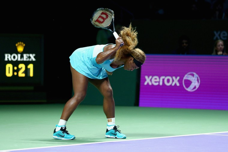Serena Williams of the United States shows her frustration as she smashes her racket on the court playing against Caroline Wozniacki of Denmark in their semi final match during the BNP Paribas WTA Finals at Singapore Sports Hub in Singapore. (Clive Brunskill/Getty Images)