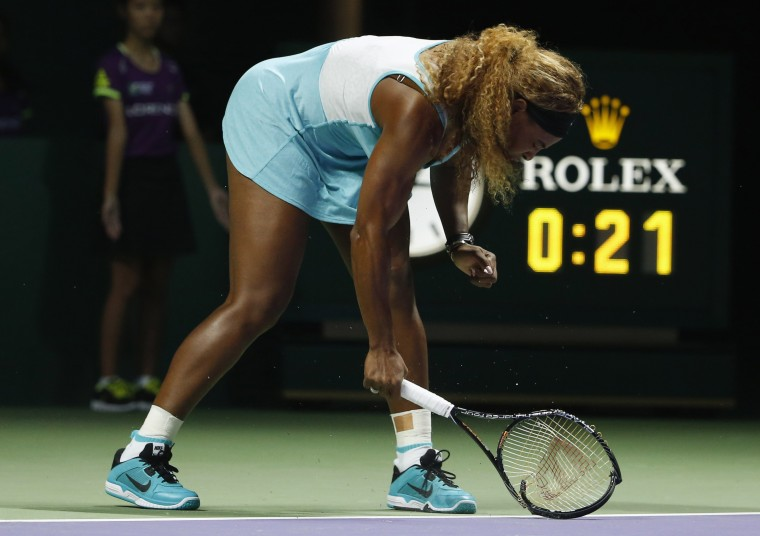 Serena Williams of the U.S. smashes her second racket during her WTA Finals singles semi-finals tennis match against Caroline Wozniacki of Denmark, at the Singapore Indoor Stadium. (Edgar Su/Reuters)