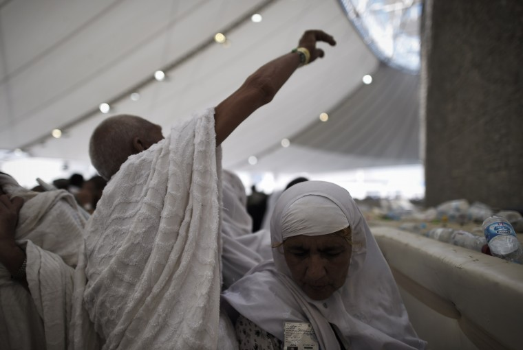 "Muslim pilgrims throw pebbles at pillars during the ""Jamarat"" ritual, the stoning of Satan, in Mina near the holy city of Mecca. Pilgrims pelt pillars symbolizing the devil with pebbles to show their defiance on the third day of the hajj as Muslims worldwide mark the Eid al-Adha or the Feast of the Sacrifice, marking the end of the hajj pilgrimage to Mecca and commemorating Abraham's willingness to sacrifice his son Ismail on God's command in the holy city of Mecca. (Mohammed Al-Shaikh/AFP-Getty Images)"