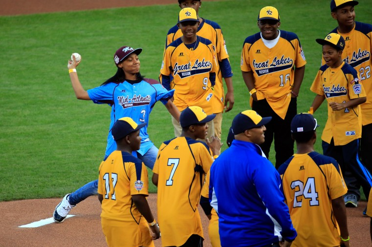 Little League Baseball pitcher Mo'ne Davis throws out the ceremonial first pitch before Game Four of the 2014 World Series at AT&T Park in San Francisco, California. (Rob Carr/Getty Images)