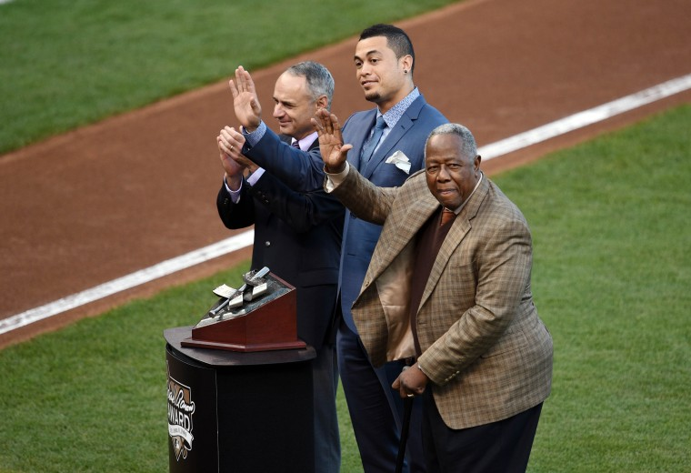Miami Marlins outfielder Giancarlo Stanton (middle) waves to the crowd as he is awarded the Hank Aaron Award by newly elected commissioner Rob Manfred (left) and Hank Aaron before game four of the 2014 World Series between the San Francisco Giants and the Kansas City Royals at AT&T Park. (Ed Szczepanski/USA Today Sports)