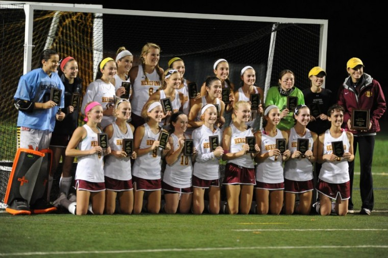 The Hereford field hockey team poses with their trophies following their 4-0 win over Dulaney during the Baltimore County field hockey championship game at Woodlawn High School. (Brian Krista/BSMG)