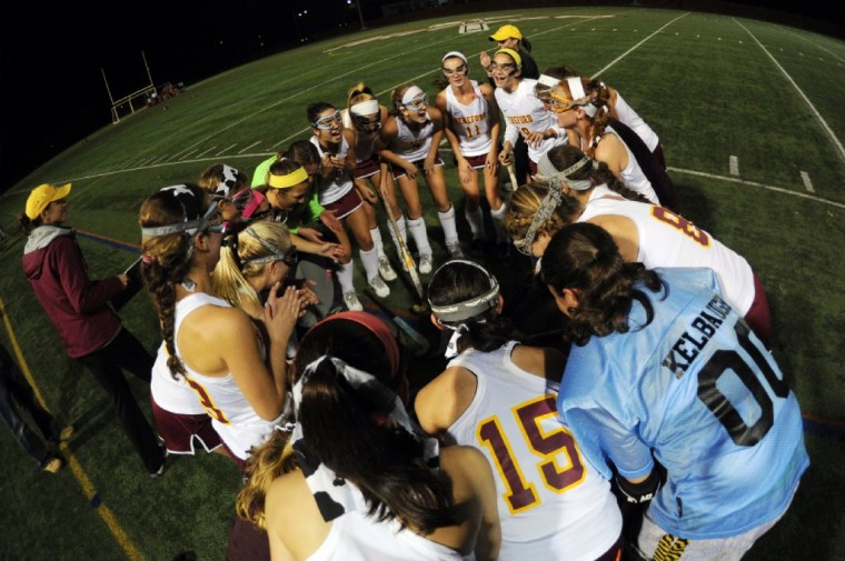Hereford players come together for a group cheer before the start of the game with Dulaney during the Baltimore County field hockey championship game at Woodlawn High School. (Brian Krista/BSMG)