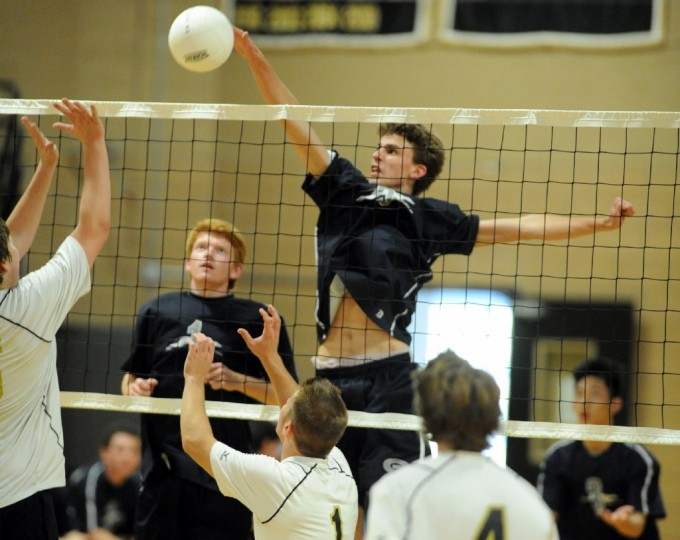 Gilman's Ben Gantt spikes the ball down on the John Carroll side of the net during a boys volleyball match at John Carroll School in Bel Air. (Brian Krista/BSMG)