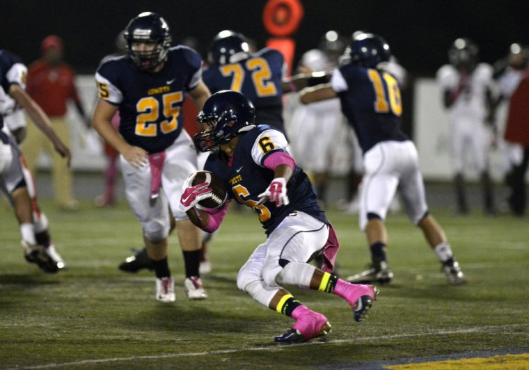 Catonsville's Brian Taylor runs the ball during Thursday's game against Woodlawn. (Nicole Munchel/BSMG)
