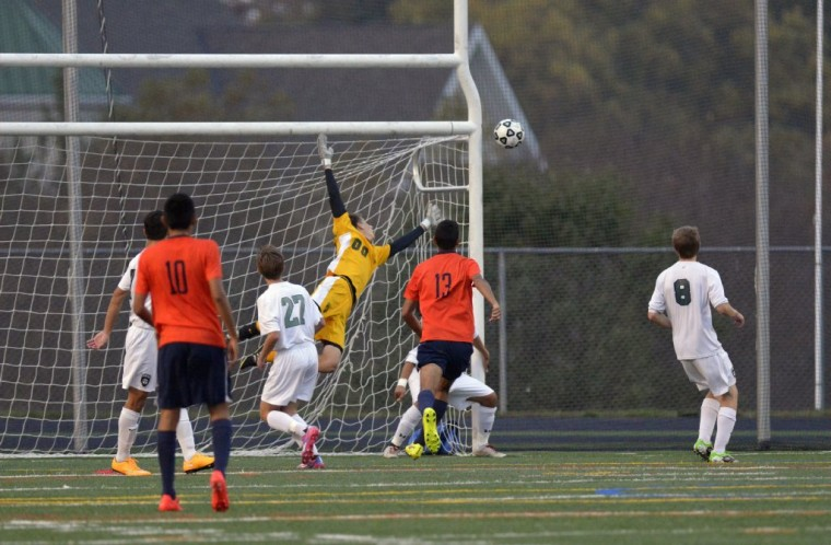 Atholton's goal keeper, Noah Bathras, dives for the ball as it soars wide in Thursday's game against Reservoir. (Nicole Munchel/BSMG)