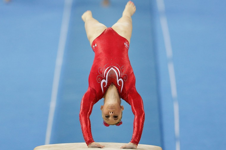 Mykayla Skinner of the United States competes on the vault during the Women's Team Final on day two of the 45th Artistic Gymnastics World Championships at Guangxi Sports Center Stadium on October 8, 2014 in Nanning, China. (Photo by Lintao Zhang/Getty Images)
