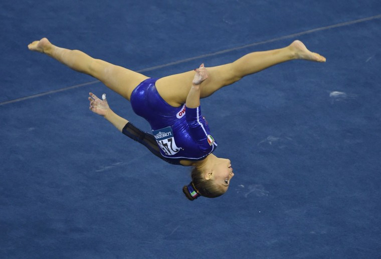 Italy's Lara Mori performs on the floor during the women's team final at the Gymnastics World Championships in Nanning. (GREG BAKER/AFP/Getty Images)
