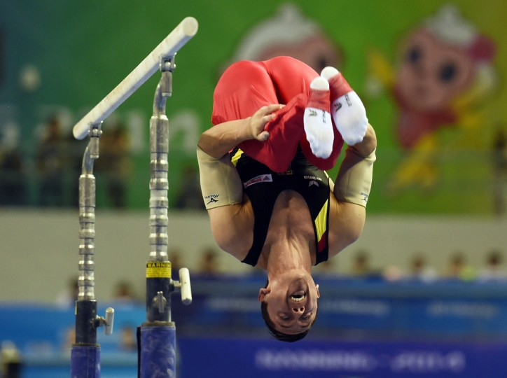 Germany's Andreas Tobas performs on the parallel bars during the men's all-around final at the Gymnastics World Championships in Nanning. (GREG BAKER/AFP/Getty Images)