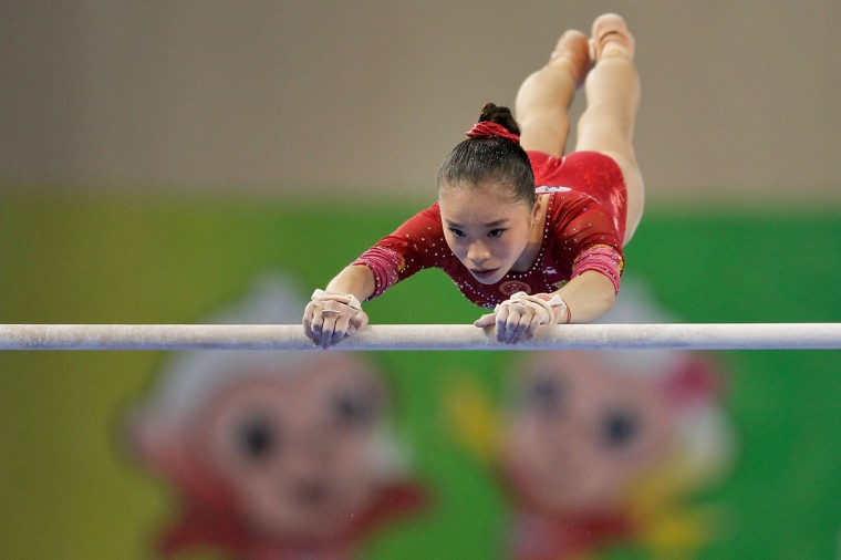 Yao Jinnan of China performs on the uneven bars during the Women's Team Final on day two of the 45th Artistic Gymnastics World Championships at Guangxi Sports Center Stadium on October 8, 2014 in Nanning, China. (Photo by Lintao Zhang/Getty Images)