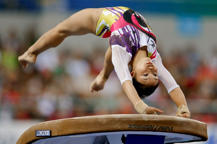 Wakana Inoue of Japan competes on the vault during the Women's Team Final on day two of the 45th Artistic Gymnastics World Championships at Guangxi Sports Center Stadium on October 8, 2014 in Nanning, China. (Photo by Lintao Zhang/Getty Images)