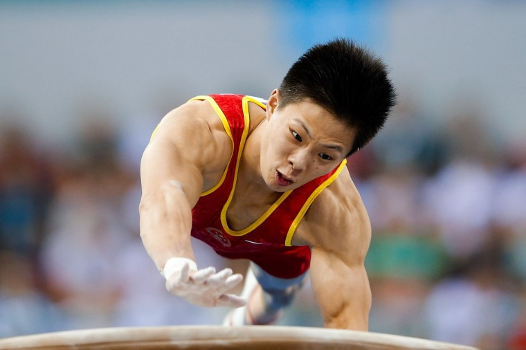 Cheng Ran of China competes on the vault during the Men's All-Around Final in day three of the 45th Artistic Gymnastics World Championships at Guangxi Sports Center Stadium on October 9, 2014 in Nanning, China. (Photo by Lintao Zhang/Getty Images)