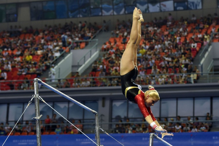 Germany's Elizabeth Seitz performs on the uneven bars during the women's qualification round at the Gymnastics World Championships in Nanning. (GREG BAKER/AFP/Getty Images)