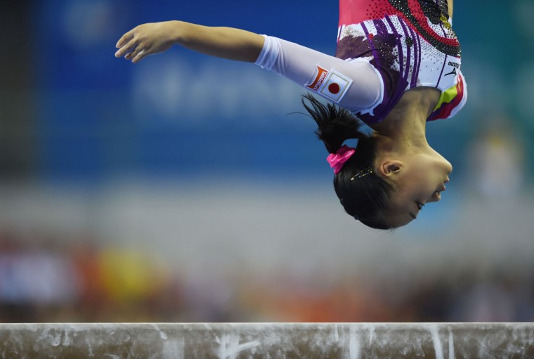 Japan's Azumi Ishikura performs on the beam during the women's qualification round at the Gymnastics World Championships in Nanning. (GREG BAKER/AFP/Getty Images)