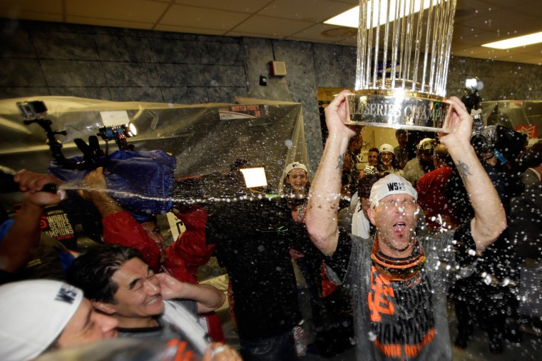 Tim Hudson #17 of the San Francisco Giants celebrates with The Commissioner's Trophy after defeating the Kansas City Royals 3-2 Game Seven of the 2014 World Series at Kauffman Stadium on October 29, 2014 in Kansas City, Missouri. (Photo by Ezra Shaw/Getty Images)