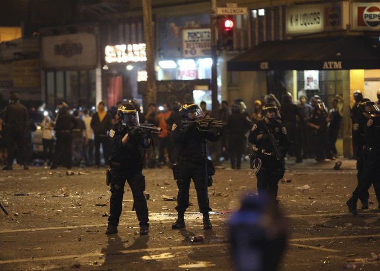Police take aim at a crowd gathered in the Mission District in San Francisco, California October 29, 2014. The San Francisco Giants beat the Kansas City Royals 3-2 on Wednesday to win their third World Series title in five seasons. (Robert Galbraith/Reuters)