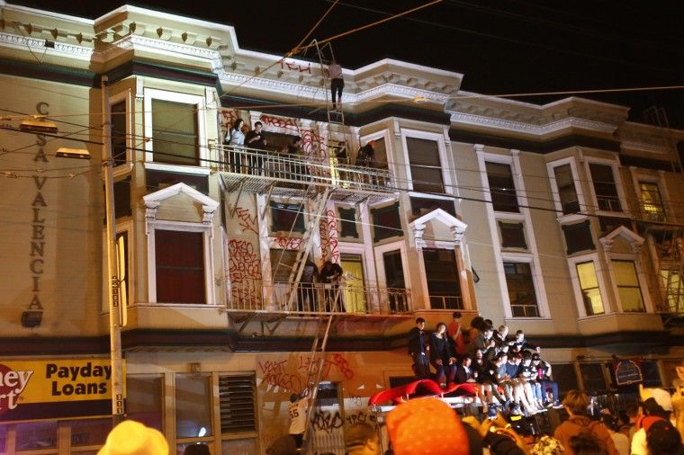 Revellers celebrate in the Mission District, in San Francisco, California October 29, 2014. The San Francisco Giants beat the Kansas City Royals 3-2 on Wednesday to win their third World Series title in five seasons. (Stephen Lam/Reuters)