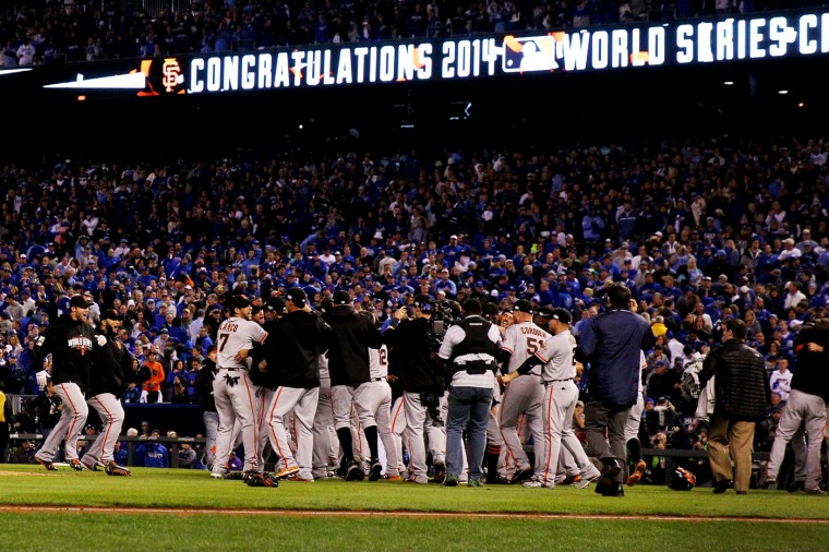 The San Francisco Giants celebrate after defeating the Kansas City Royals to win Game Seven of the 2014 World Series by a score of 3-2 at Kauffman Stadium on October 29, 2014 in Kansas City, Missouri. (Photo by Ezra Shaw/Getty Images)